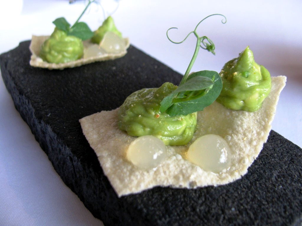 Poppadom crackers with wasabi cream for welcome.